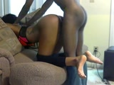 Ebony chick fucked on the sofa